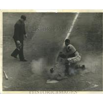 1955 Press Photo Dust Rolls at Home Plate as Del Crandall Tags Wally Post Out
