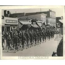 1940 Press Photo Troops Marching Down Main Street - fux00383