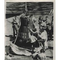 1962 Press Photo Astronaut Walter M. Schirra is helped from Sigma 7 spacecraft.