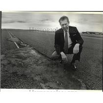 1988 Press Photo Vernon Olgard inspects patch in main runway Spokane Airport