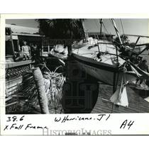 1995 Press Photo Hurricane Opal- Workers ponder next move on the beach.