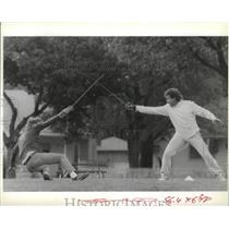 1989 Press Photo Severson and Jack Green practice and sharpen fencing skills