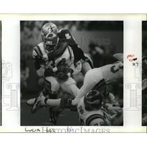 1991 Press Photo New Orleans Saints- Saint's Pat Swilling drops Herschel Walker