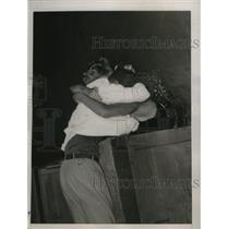 1936 Press Photo Spouse of Lenora Kight Wingard gives her a big kiss - nef53548