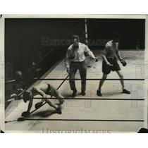 1951 Press Photo Boxer Jimmy Farley knocks down Louis Raines in match