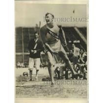 1929 Press Photo Leo Baldwin Shown Making Toss That Broke Discus Record in Texas