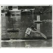 1976 Press Photo Lafitte Pirogue Race - Gary Angelette Paddles in Race