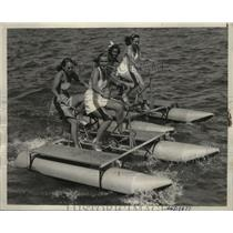 1939 Press Photo girls enjoying aquatic tandem bikes on Lake Tahoe - neo09526