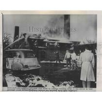 1951 Press Photo Firemen Pour Water on Building After Being Struck by C-46 Plane