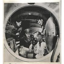 1944 Press Photo Crew member look at Interior view of the B-29 Superfortress