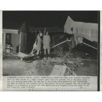 1951 Press Photo Santa Monica Detectives Check Wrecked Monoplane That was Stolen