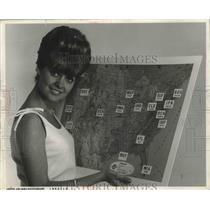 1966 Press Photo Karen Van Ort of United Air Lines' Displays Map of Routes