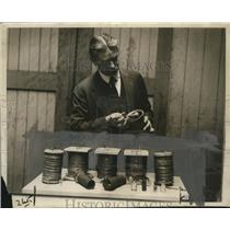 1924 Press Photo Perlin Charter Mass State Chemist with collection of Bomb found