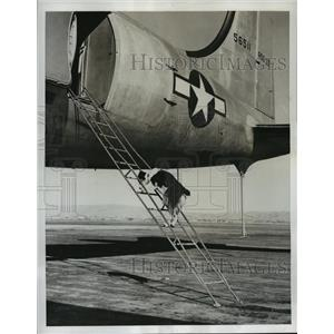 1946 Press Photo Bosoc the dog climbs R5D Skymaster at Moffett Field