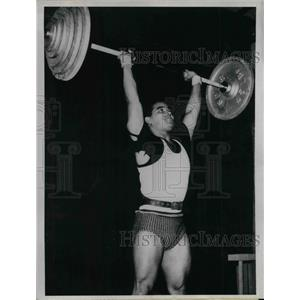 1962 Press Photo A.N. Ghosn Indian navy lifts weight