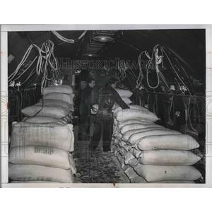 1948 Press Photo Workers Loading Flour On C-57 Transport Plane To United States