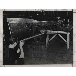 1948 Press Photo Telescope to inspect rivets in wings of airplane at Boeing Co