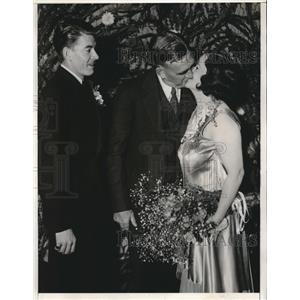 1933 Press Photo Groom Looks On Helplessly as Chapel Owner Kisses His New Bride