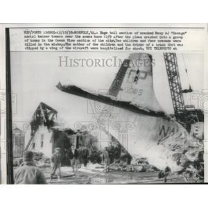 1958 Press Photo The tail section of a plane wreckage of a Navy tanker tower