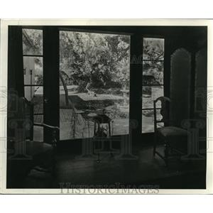 1940 Press Photo Jane Buell flower garden seen thru window at her home