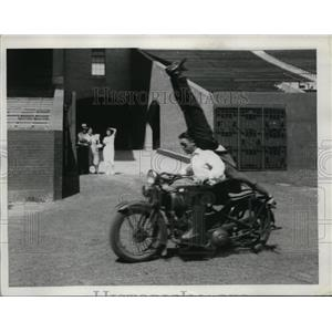 1923 Press Photo two men performing motorcycle stunt
