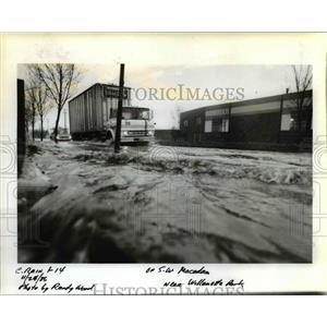 1986 Press Photo Trucks test their ability to be amphibious Monday - orb12145