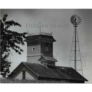 1965 Press Photo Barn silo and windmill on farm in Columbia County - orb11400