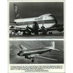 1985 Press Photo Dwarfed by a Boeing 747, a DC-3 prepares to take off
