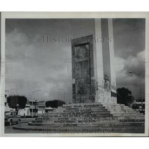 1962 Press PhotoSlogan of various political parties on monument in Santo Domingo