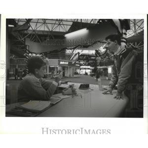 1993 Press Photo Helen Reinke, Travelers Aid, Mitchell Airport and Aaron Mertes