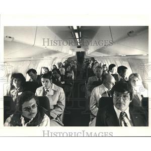 1987 Press Photo Passengers inside an Aircraft  - hca04743