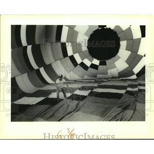 """1988 Press Photo Chris Burry makes adjustments inside """"Dubloon"""" before lift-off."""