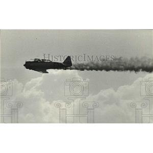 1986 Press Photo Plane flies upside down at Brookley air show in Alabama