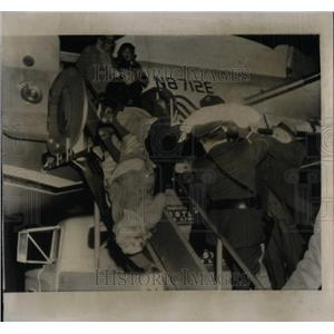1935 Press Photo Patient falls from Stretcher flown fro - RRX11649
