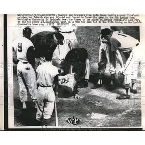 1963 Press Photo Indian catcher Doc Edwards injured by Senators Ed Brinkman