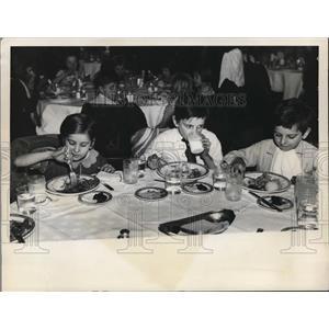 1938 Press Photo of three boys enjoying a big meal. - nee18200