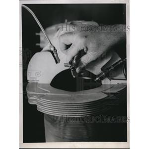1945 Press Photo A man holding a bendix-stromberg direct fuel injection