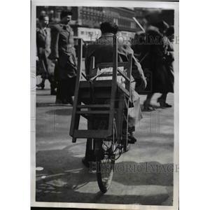 1952 Press Photo Paris Bicyclist Carries a Chair on his Bike - nee36511