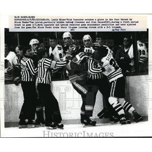 1952 Press Photo St Louis Blues Rick Lapointe hit by Black Hawk Tom Lysiak