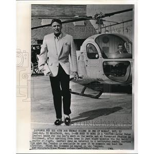 1964 Wire Photo Actor Peter Lawford goes to his movie set riding a helicopter