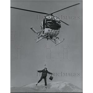 1991 Press Photo Annette Hosking dangles from a hook during stunt. - orb14200