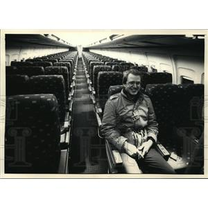 1988 Press Photo The seats of a Boeing 737-300 stretch out behind Peter Moll
