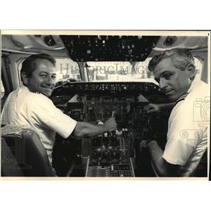 1987 Press Photo Capt. Bob Paty and Tom Young at the cockpit of MD-80 aircraft