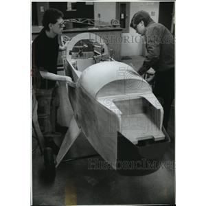 1994 Press Photo Dan Scholz & Adam Pfaff sand a section of ultralight's cockpit