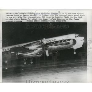 1961 Press Photo Damaged Eastern Airlines Electra Plane Landing at Logan Airport