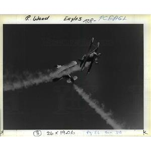 1988 Press Photo Two member of the Eagles Aerobatic Team cross trails in a close