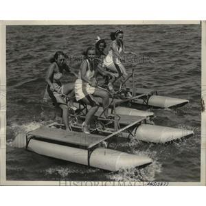 1939 Press Photo girls enjoying aquatic tandem bikes on Lake Tahoe - neo09526