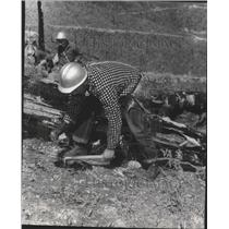 1957 Press Photo A group of workers digging in the forest - spa70353