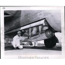 1961 Press Photo Engineer at Lewis Research Center Inspects Airplane Package