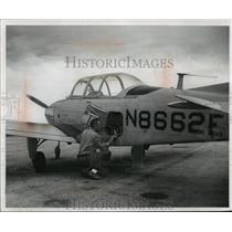 1960 Press Photo Warden Don Beghin with boat patrol aircraft, in Wisconsin.